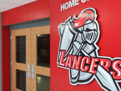 North Scott Lancers logo on a wall