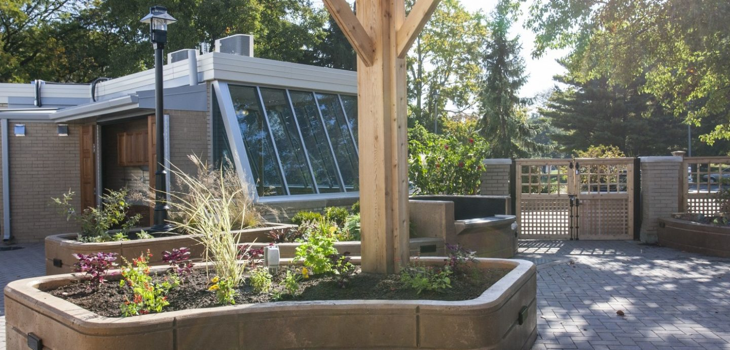 Patio garden with wooden beam holding up canopy