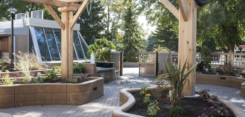 Outdoor patio with walled garden islands