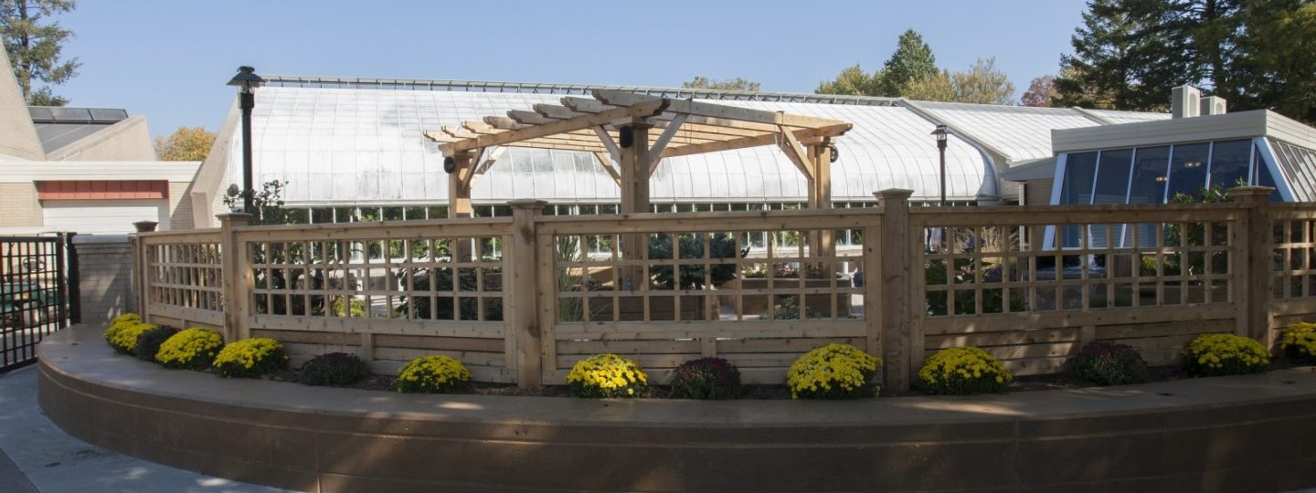View of a wooden fence around patio garden
