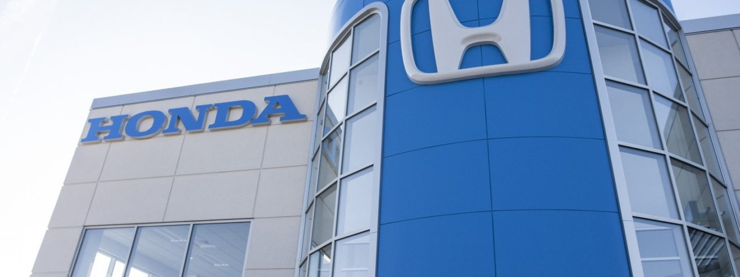 Exterior building shot with Honda icon and text on wall