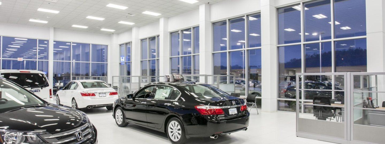 Zimmerman Honda interior showroom with black Honda Accord in the center