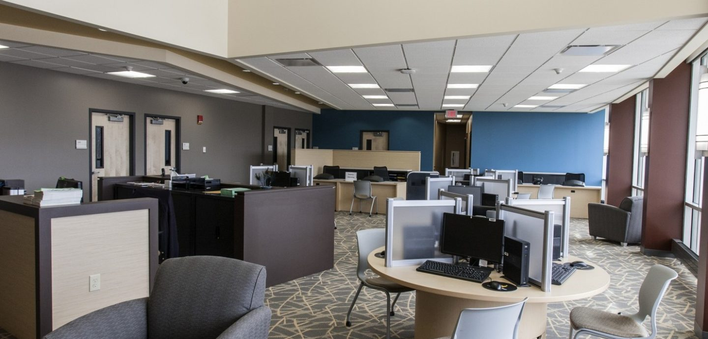 Black Hawk College student lounge with computers and chairs