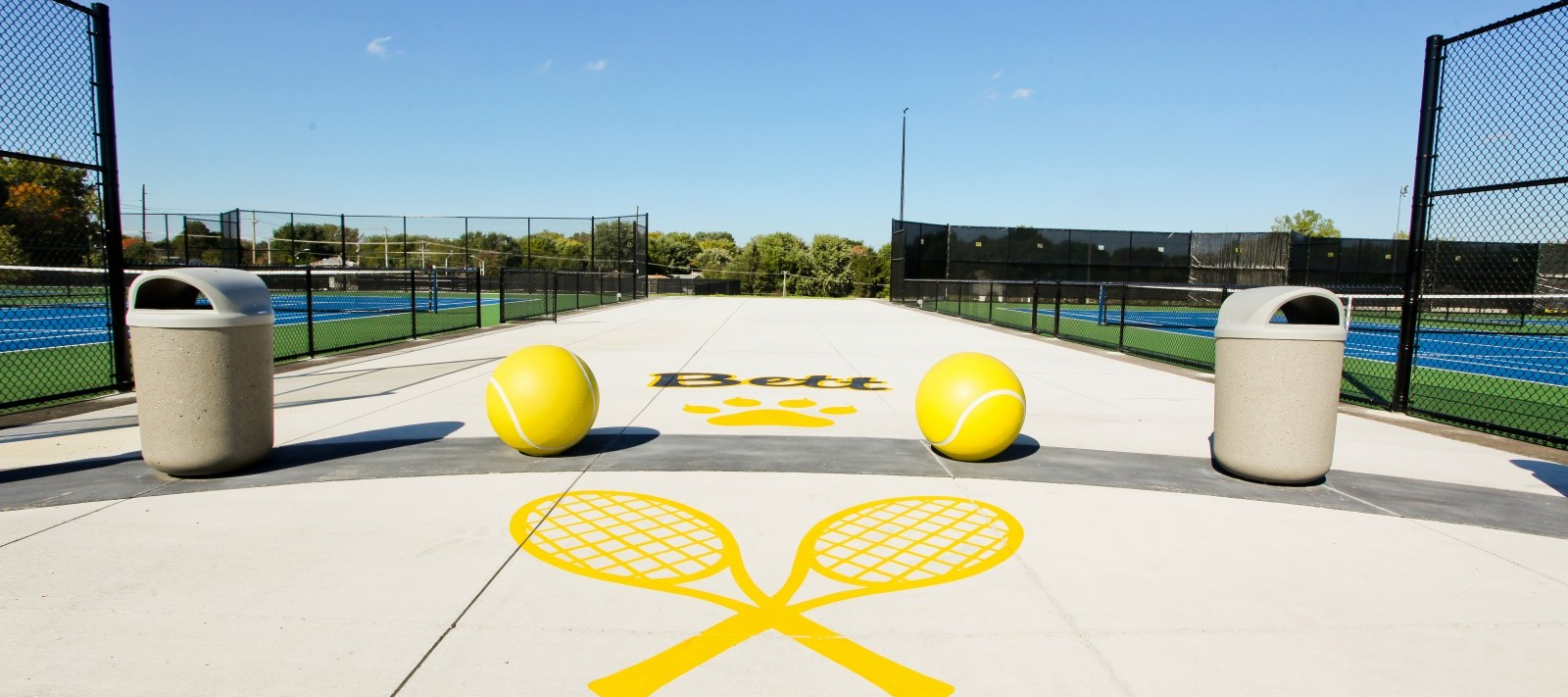Bettendorf tennis courts entrance with giant concrete tennis balls