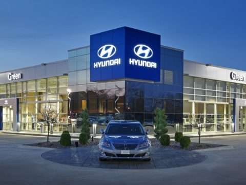 Green Hyundai dealership exterior at night