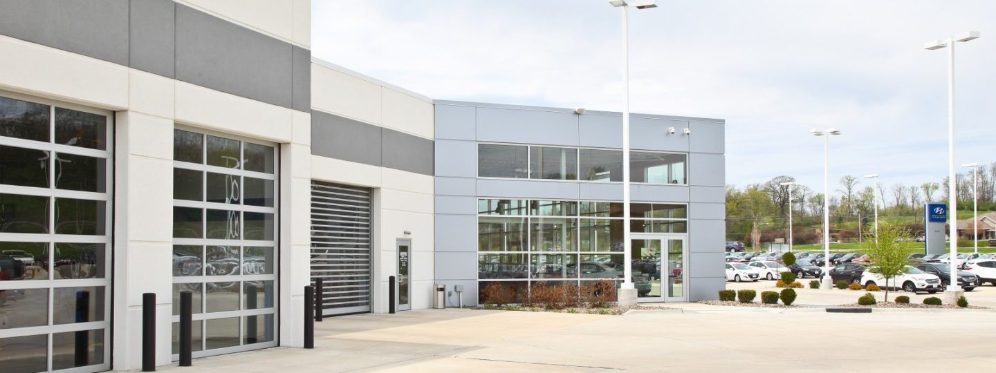 Green Hyundai dealership service center exterior entrance