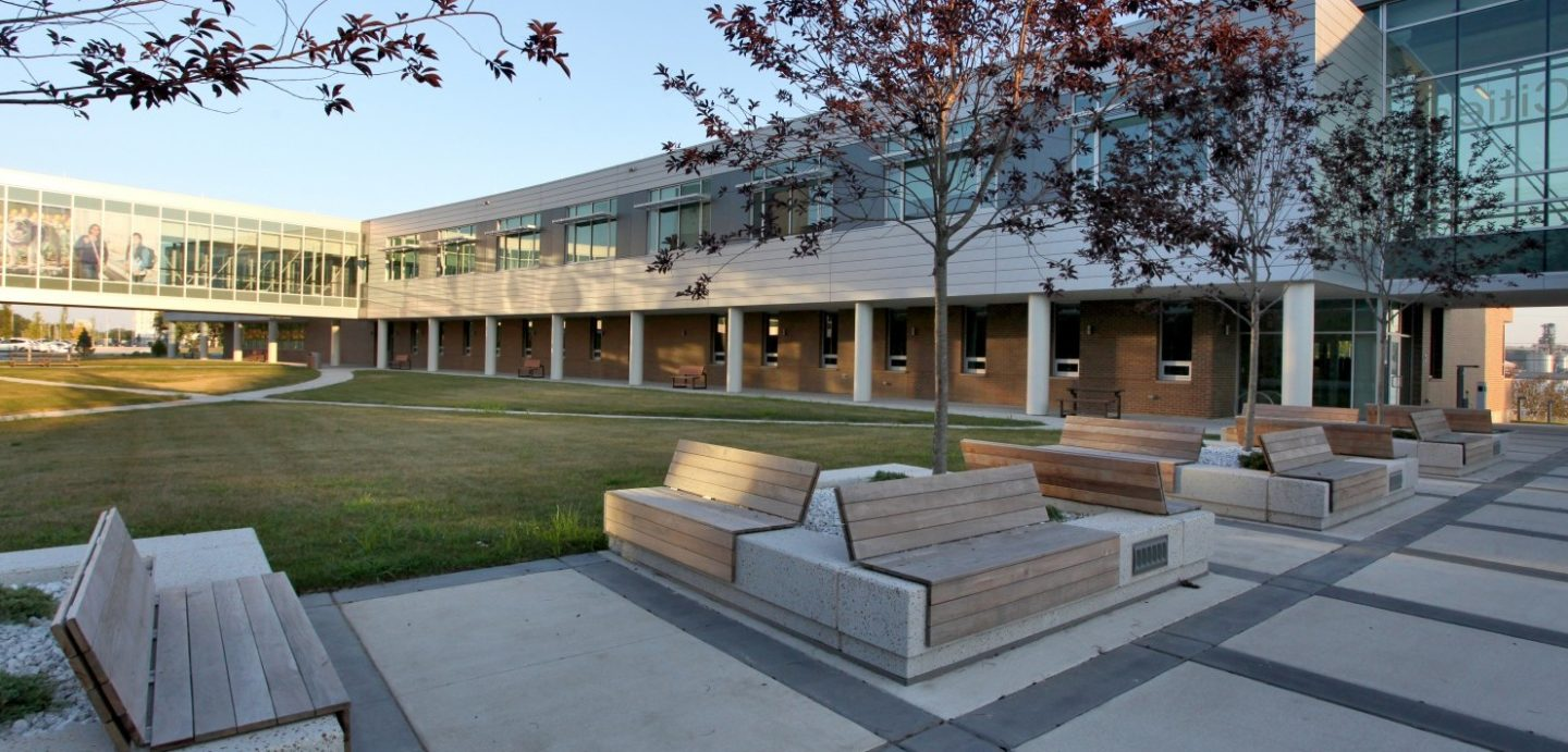 Wooden slat benches on a concrete slab at Western Illinois University Riverfront campus