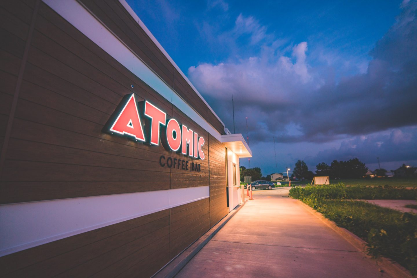 Atomic Coffee stand side view with logo
