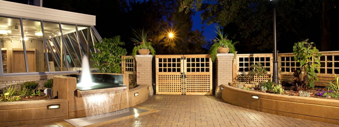 Patio garden entrance with wooden gate