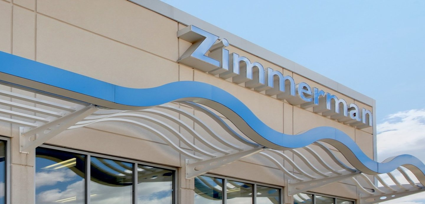 Exterior building shot with Zimmerman text on wall