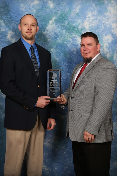 Rob Davis receiving an award with Jarod Engler.