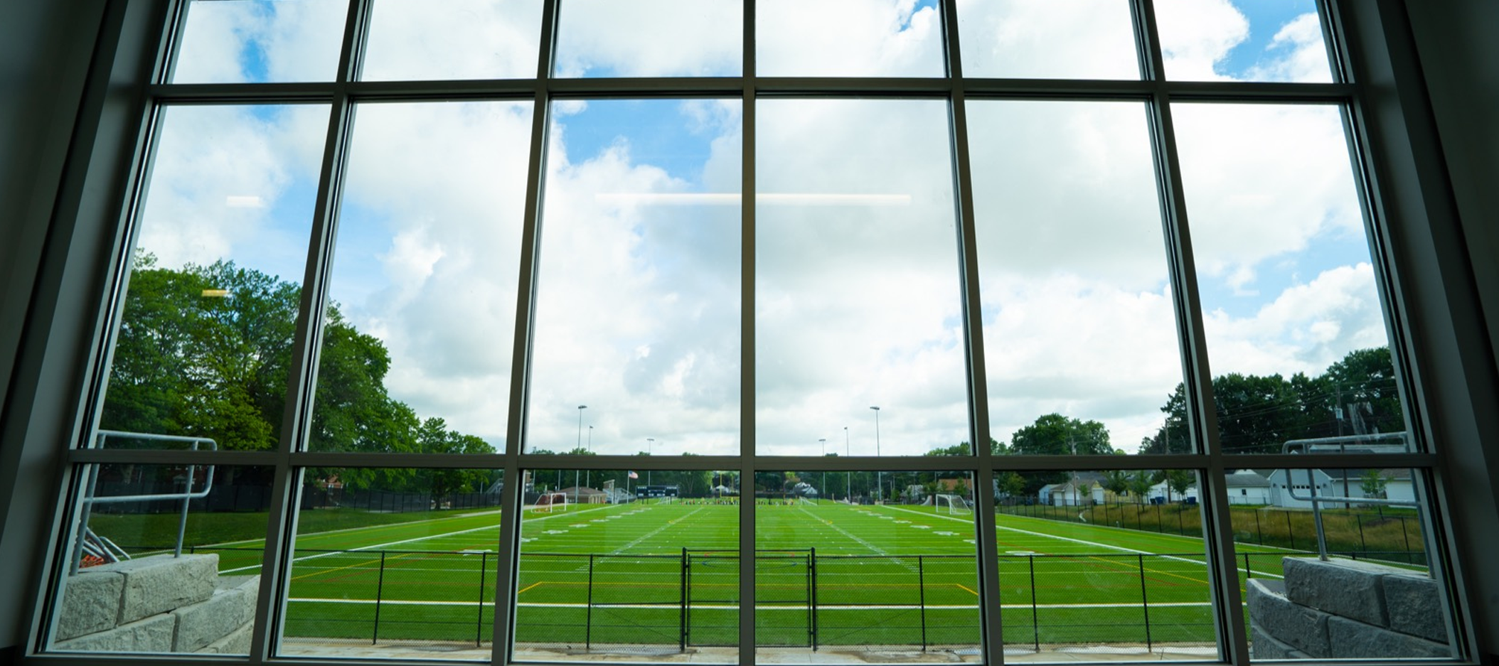 header image of window looking out to football field