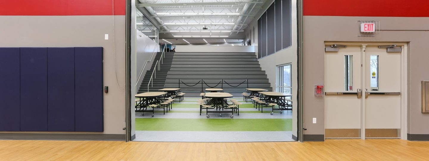 Modern designs and concepts can be seen throughout the new Mark Twain Elementary School, such as this one featuring a garage door from the gym to the cafeteria