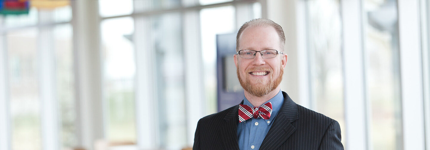 Professional white man in glasses with short beard and a bow tie.