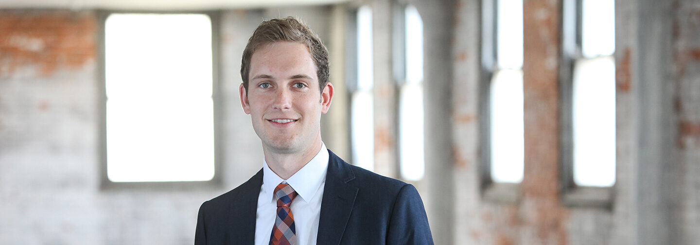 Young white male professional wearing a suit.