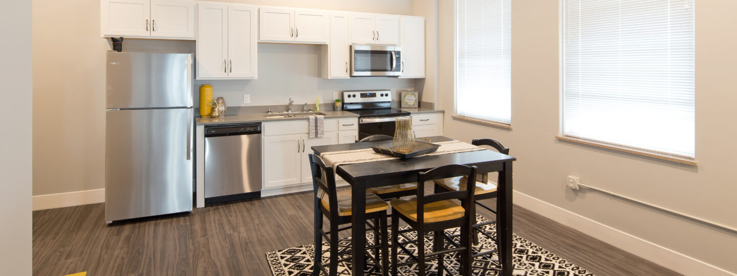 This image represents a kitchen within one of the Hershey Lofts' units in Muscatine, Iowa