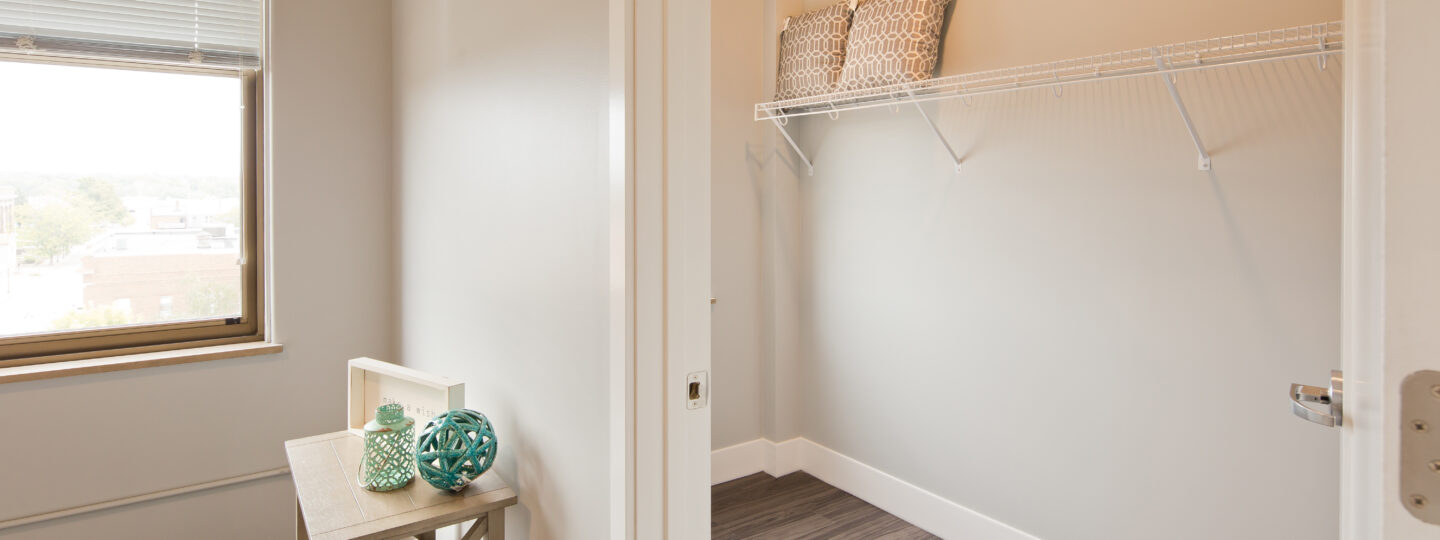 This image displays a spacious walk-in closet at Hershey Lofts in Muscatine, Iowa