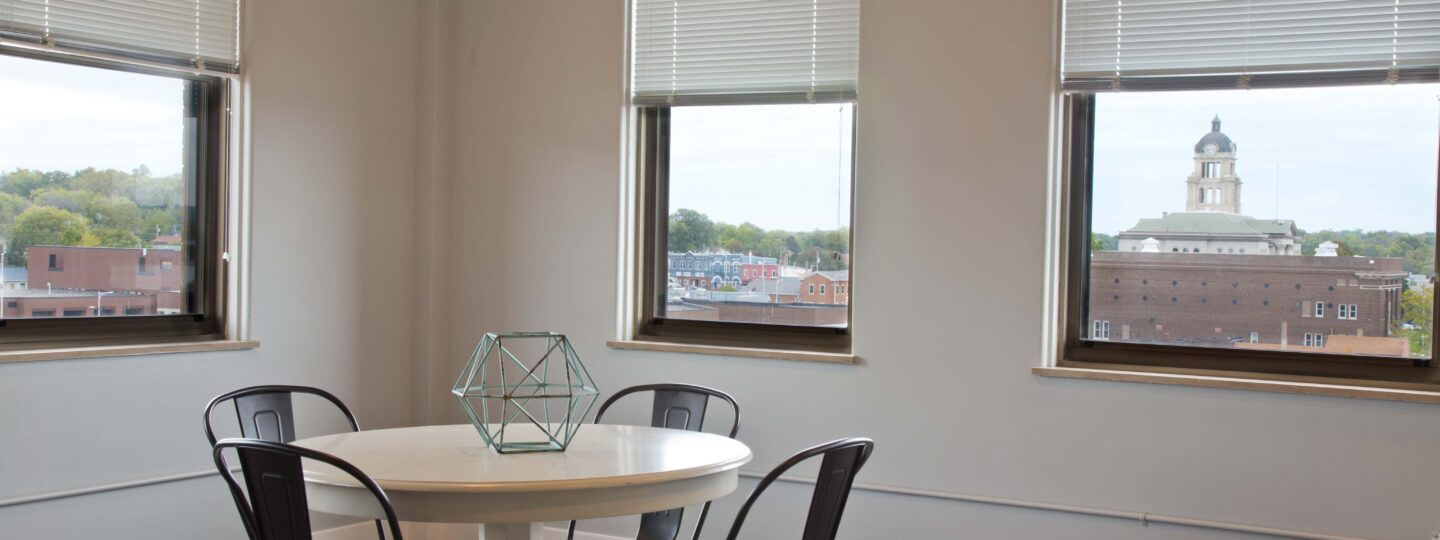 This image displays the views from a dining room at the Hershey Lofts in Muscatine, Iowa